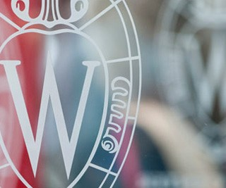 The UW–Madison crest, as applied to The Office of Corporate Relations.
